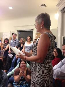 "Candice Wynne regales the audience with her story, ""A Whistle and a Bucket of Sand.""  Photo:  Alicia Kat Vancil"